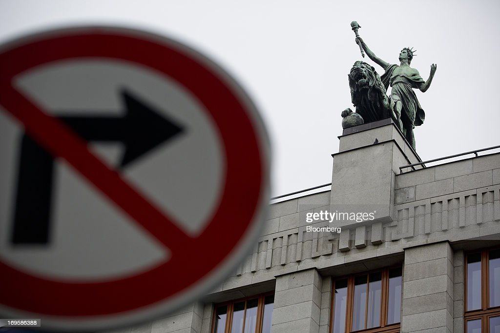 A road sign stands outside the headquarters if the Czech central bank in Prague, Czech Republic, on Monday, May 27, 2013. Czech policy makers are in uncharted territory as they debate whether the first koruna sales in a decade are needed to meet their inflation target as the economy has shrunk for five quarters, the longest contraction since at least 1996. Photographer: Martin Divisek/Bloomberg via Getty Images