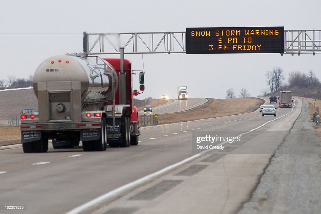 A road sign warns northbound traffic in Interstate 380 of the snow storm on February 22, 2013 outside Iowa City, Iowa. Dozens of states and millions of residents are threatened by the winter storm that's crossing the nation.