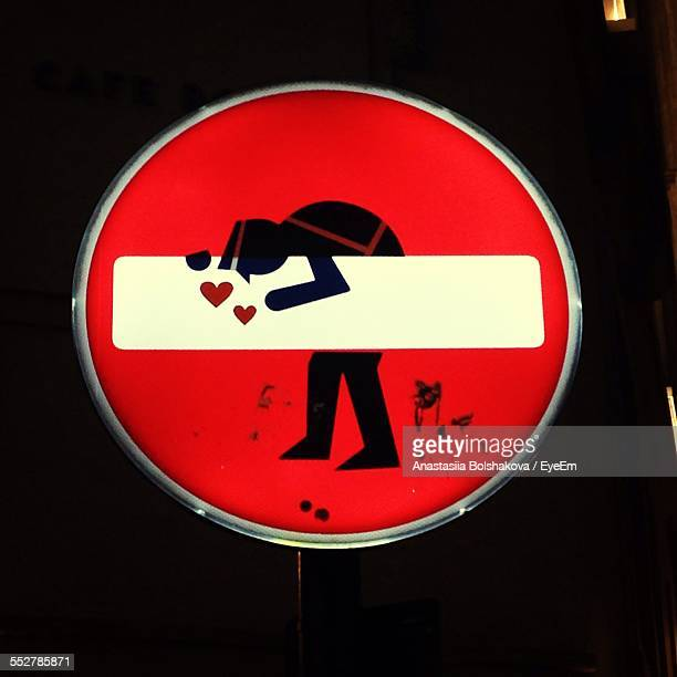 Road Sign With Heart And Man Drawn At Night