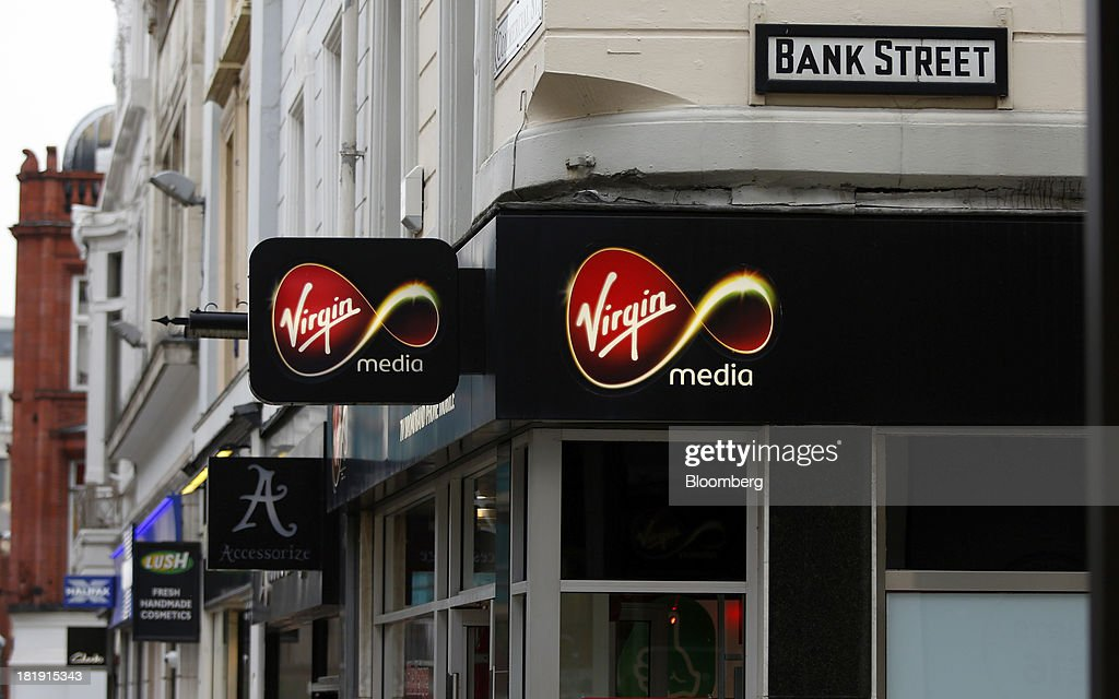 A road street sign for 'Bank Street' sits above a Virgin Media store in Leeds, U.K., on Wednesday, Sept. 25, 2013. The parent of Co-operative Bank, which is seeking capital after losses, may avoid being forced to rescue the lender thanks to an accord it struck with regulators last year, according to bondholders. Photographer: Paul Thomas/Bloomberg via Getty Images