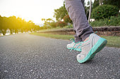 Road to success,running on road with sports shoes,healthy lifestyle sports woman running, female legs with sneakers jogging in evening prepare for marathon