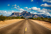A long remote road leading to the base of famous Superstition Mountain in Arizona shows the beauty of this desert landscape.