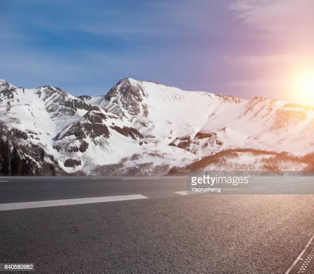 Road to the mountain covered by snow.Mountain name is Changbaishan (Changbai Mountai) located at north China,near to North Korea