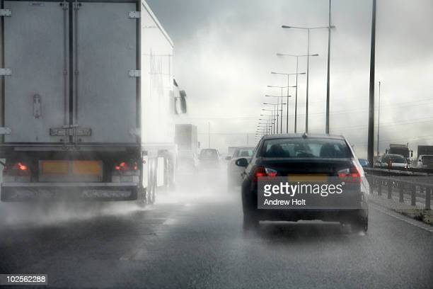 Road traffic driving in bad weather on motorway