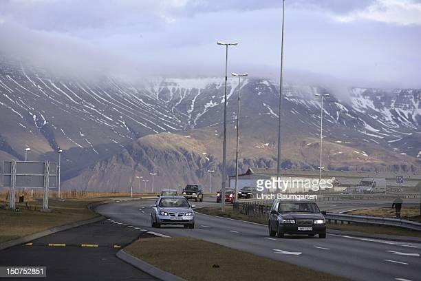 ICELAND REYKJAVIK Road traffic on the outskirts of Reykjavik