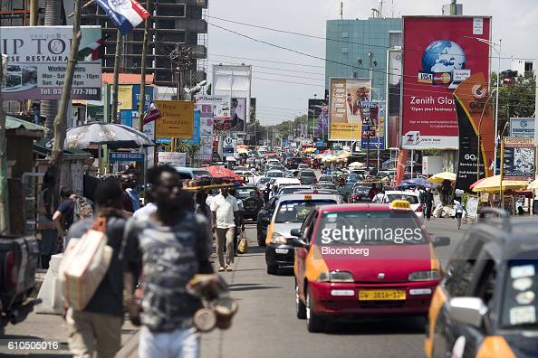 Road traffic passes business advertisements for Zenith Bank Plc and MTN Group Ltd sit on a busy highway in Accra Ghana on Monday Sept 19 2016 Ghana's...