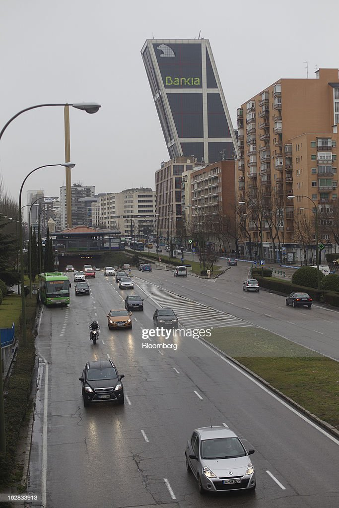 Road traffic passes one of the Kio towers, headquarters of Bankia SA, in Madrid, Spain, on Thursday, Feb. 28, 2013. BFA-Bankia Chairman Jose Ignacio Goirigolzarri said a balance sheet clean-up that inflicted a 21.2 billion-euro ($27.6 billion) after-tax loss last year will set the Spanish banking group on course to repay state aid. Photographer: Angel Navarrete/Bloomberg via Getty Images