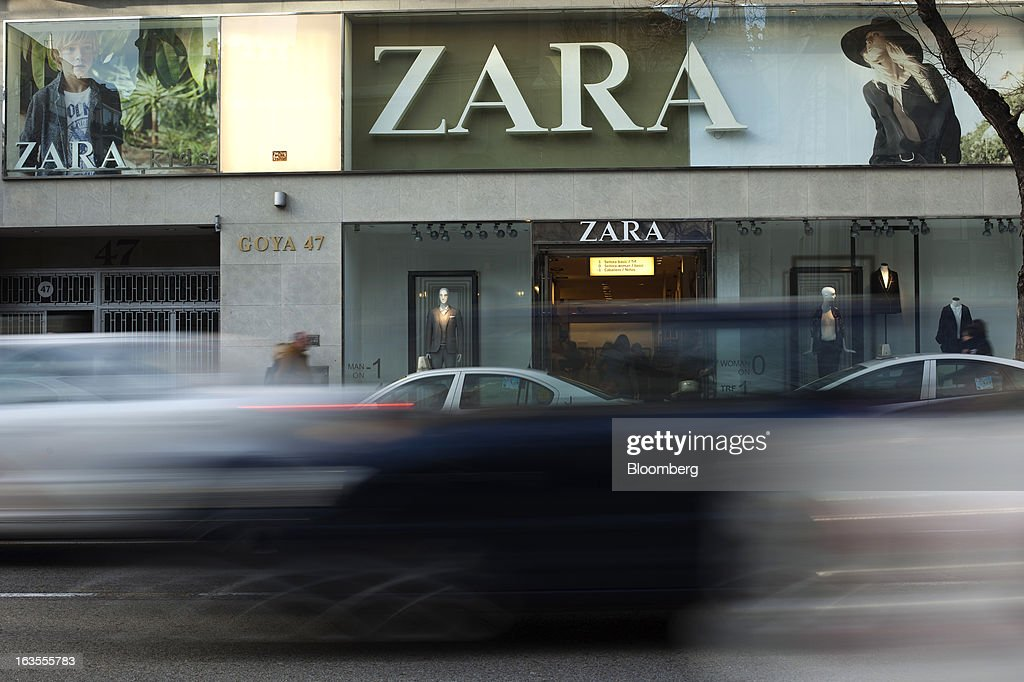 Road traffic passes the entrance to a Zara fashion store, operated by Inditex SA, in Madrid, Spain, on Tuesday, March 12, 2013. Europe's richest man, Amancio Ortega, the 76-year-old founder of Inditex SA, the world's biggest clothing retailer and owner of the Zara clothing chain, is No. 3 on Standard & Poor's 500 Index with a net worth of $57.4 billion, $4.9 billion ahead of Warren Buffett, 82. Photographer: Angel Navarrete/Bloomberg via Getty Images