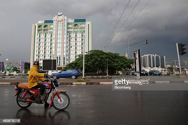 Road traffic passes the head office of Unity Bank Plc in Abuja Nigeria on Wednesday Oct 21 2015 A drop in crude prices in the past year has put...