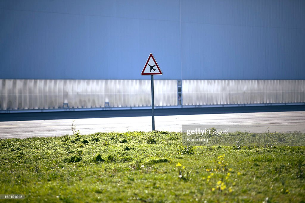 A road traffic sign alerting drivers to passing aircraft is seen on the perimeter road near to the Air France engineering and maintenance facility, part of the Air France-KLM Group, at Toulouse-Blagnac airport in Toulouse, France, on Tuesday, Feb. 19, 2013. Air France-KLM, Europe's biggest airline, has been revamping its regional operations in an effort to end years of losses. Photographer: Balint Porneczi/Bloomberg via Getty Images
