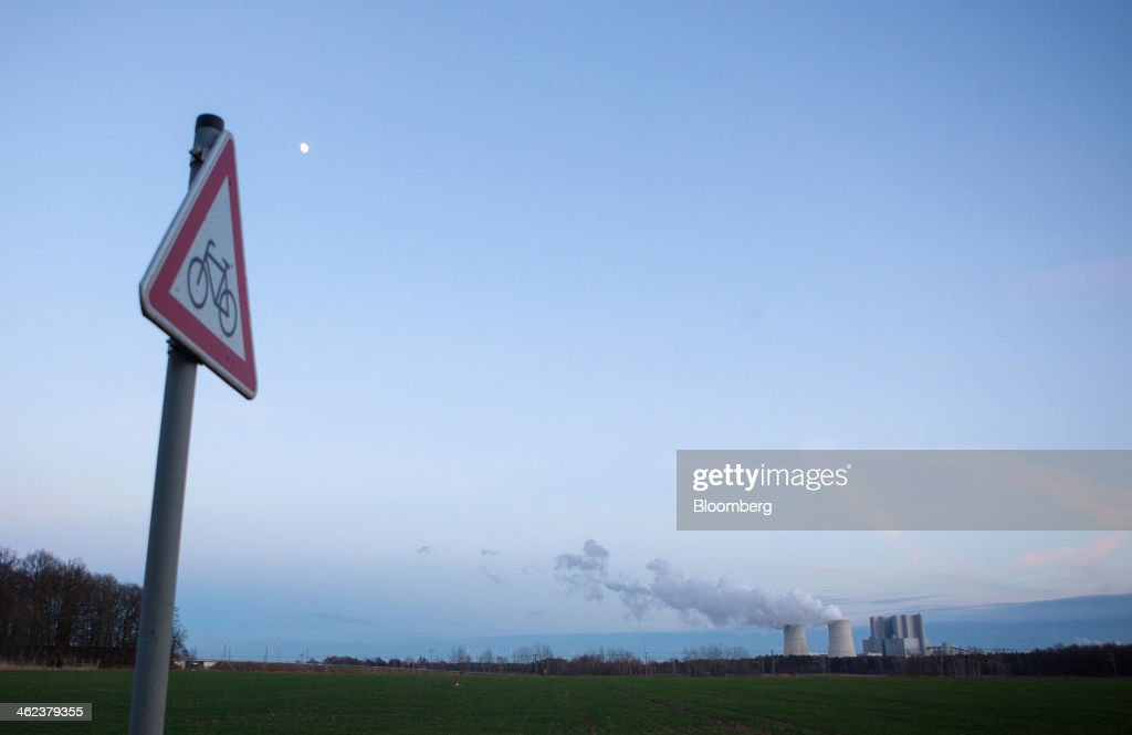 A road traffic sign stands as vapor rises from the cooling towers of the Schwarze Pumpe lignite powered power plant, operated by Vattenfall AB, in Spremberg, Germany, on Saturday, Jan. 11, 2014. Across the continent's mining belt, from Germany to Poland and the Czech Republic, utilities such as Vattenfall AB, CEZ AS and PGE SA are expanding open-pit mines that produce lignite. Photographer: Krisztian Bocsi/Bloomberg via Getty Images