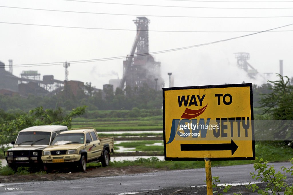 A road traffic sign stands near the JSW Steel Ltd. manufacturing facility in Dolvi, Maharashtra, India, on Friday, July 27, 2013. JSW Steel is scheduled to announce first-quarter earnings on July 31. Photographer: Adeel Halim/Bloomberg via Getty Images