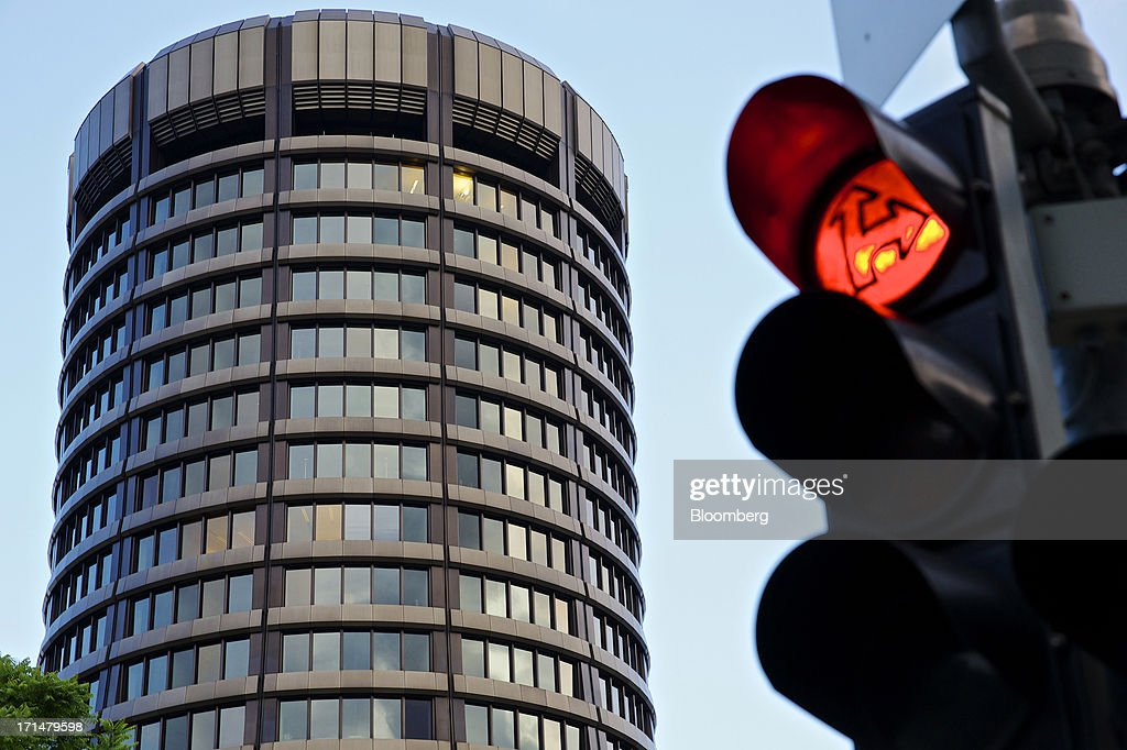 A road traffic signal stands near the headquarters of the Bank for International Settlements (BIS) in Basel, Switzerland, on Tuesday, June 25, 2013. Central banks can't expand loose monetary policy without exacerbating risks to world economies, the Bank for International Settlements said this week. Photographer: Gianluca Colla/Bloomberg via Getty Images