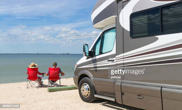 Road trip in USA, couple relaxing near water