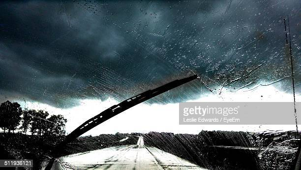 Road viewed through windshield in rain