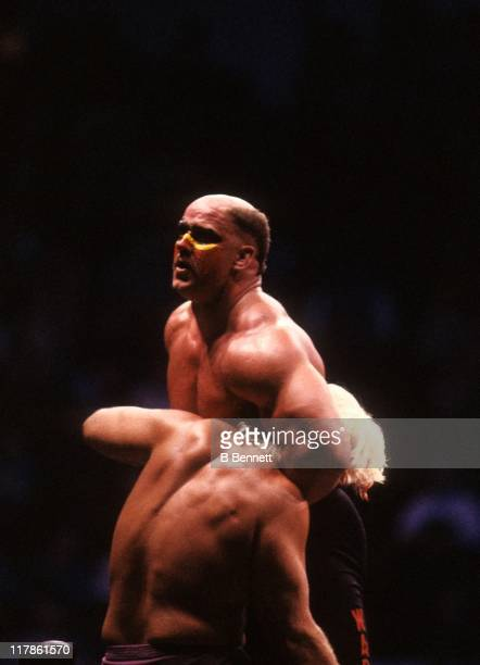 Road Warrior Hawk gets ready to perform the suplex on the 'Nature Boy' Rick Flair during their Heavy Weight bout at the 1988 Bunkhouse Stampede on...