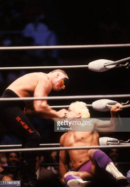 Road Warrior Hawk punches the 'Nature Boy' Rick Flair in the corner during their Heavy Weight bout at the 1988 Bunkhouse Stampede on January 24 1988...
