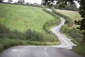 Road Winding Its Way Through The Countryside