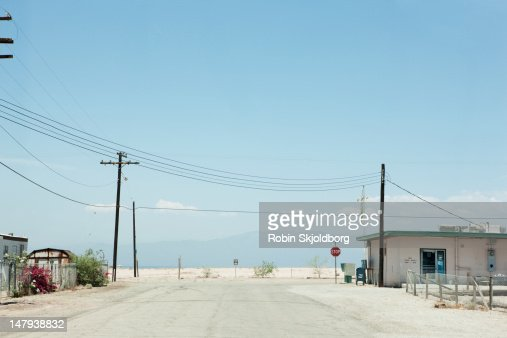Road with a stop sign : Stock Photo