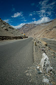 Road with high hill from Pangong - Nubra Route trip high land Himalaya.