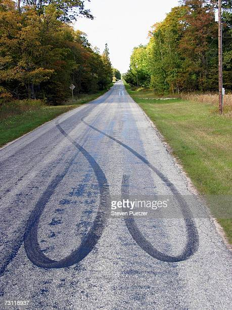 Road with tire marks on surface