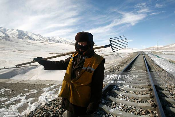 A road worker carries out track maintenance along a line segment of the QinghaiTibet railway on December 2 2008 in Haixi Mongol and Tibetan...