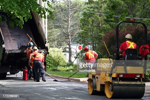 Road workers repairing a pothole
