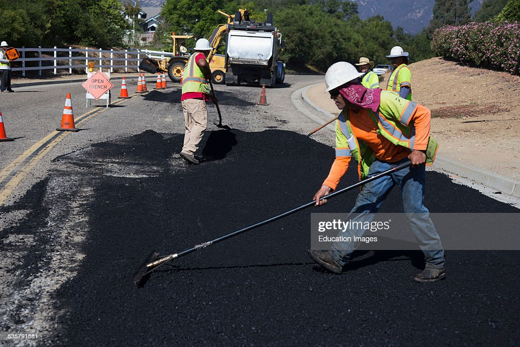 Road workers repaves road with steam Encino Drive Oak View California
