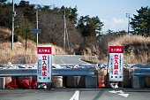 A roadblock keeps drivers from entering the restricted zone around the Fukushima Daiichi Nuclear Power Plant