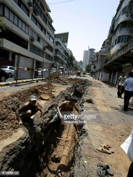 Roads Construction Drainage Drain Repair Road Repairing Sewer PipeLine construction at Peddar Road in Mumbai on Sunday BMC official said that they...