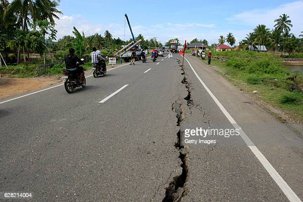 Roads cracked in the quake of 64 magnitude on December 7 2016 in Sigli Aceh Province Indonesia An undersea earthquake struck Indonesia's northern...