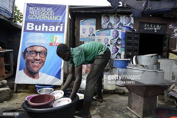 A roadside restaurant features on March 12 2015 a poster of main opposition All Progressives Congress presidential candidate Mohammadu Buhari in...
