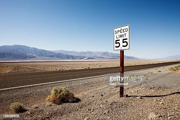 Roadside sign in desert landscape