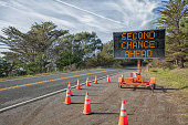 SECOND CHANCE AHEAD: This is a photograph of a mobile roadside sign parked on highway one in northern California. It is a trailer and powered by batteries and provides information and warnings for dri