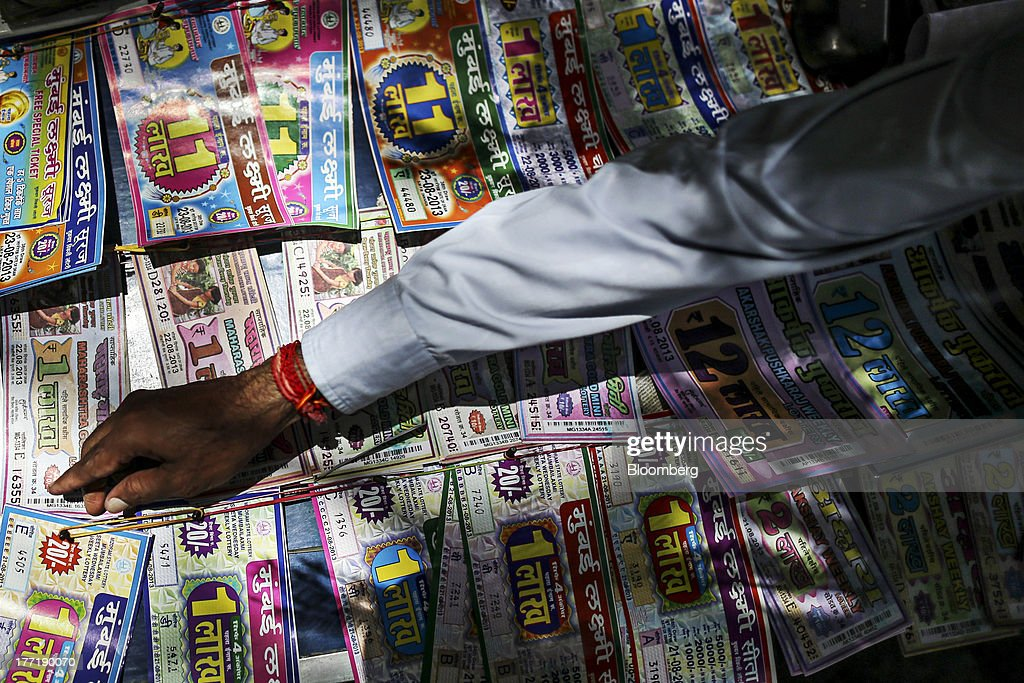 A roadside vendor arranges lottery tickets in Mumbai, India, on Wednesday, Aug. 21, 2013. The prospect of an indecisive 2014 election in India is eroding confidence among global investors that the government can stop the rupees worst drop in more than two decades. Photographer: Dhiraj Singh/Bloomberg via Getty Images