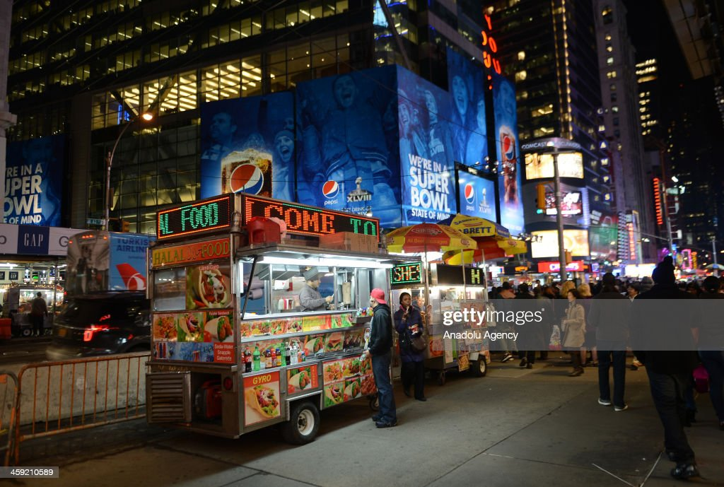 Roadside vendors prepare street food at the Times Square Bryant Park and Rockefeller Center the places visited especially by tourist from all over...