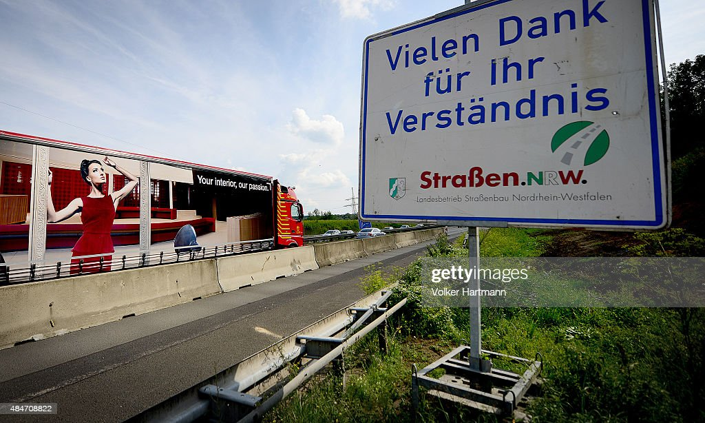 Roadsign stands at a construction site of a new bridge along the A45 highway on August 20 2015 near Hagen Germany while traffic flows along next to...