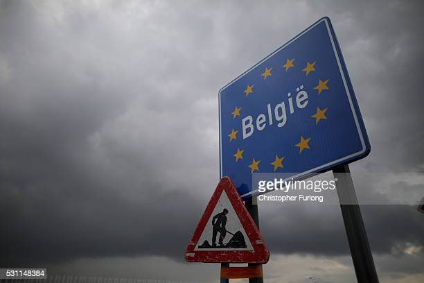 A roadworks warning sign is attached to a Belgian EU border sign on May 10 2016 in Adinkerke Belgium The Schengen Agreement which led to the creation...