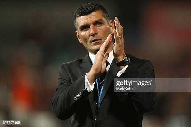 Roar coach John Aloisi look dejected after defeat as he applauds the crowd during the ALeague Semi Final match between the Western Sydney Wanderers...
