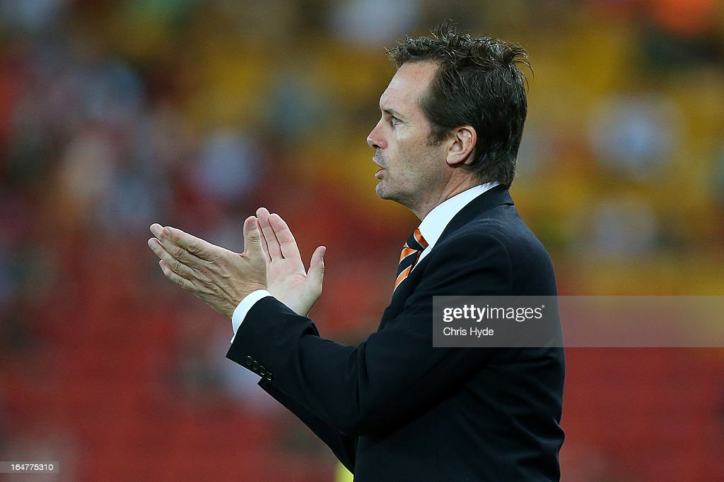 Roar coach Mike Mulvey looks on during the round 27 A-League match between the Brisbane Roar and Sydney FC at Suncorp Stadium on March 28, 2013 in Brisbane, Australia.