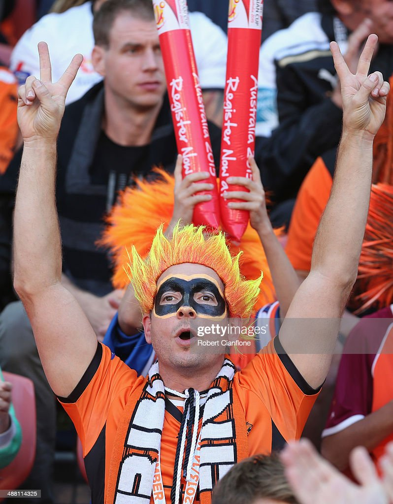 A Roar fan cheers during the 2014 A-League Grand Final match between the Brisbane Roar and the Western Sydney Wanderers at Suncorp Stadium on May 4, 2014 in Brisbane, Australia.