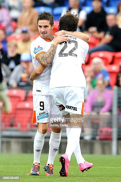 Roar team mates celebrate a goal from Jamie Maclaren during the round eight ALeague match between the Newcastle Jets and Brisbane Roar at Hunter...