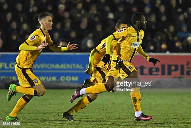 Roarie Deacon of Sutton United celebrates scoring his sides first goal with his Sutton United team mates during the Emirates FA Cup third round...