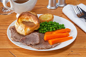 Roast Beef and Yorkshire Pudding - with gravy, roast potatoes, peas and carrots.