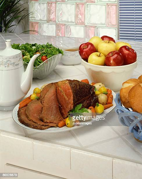 Roast beef , vegetables and fruit
