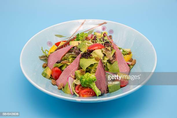 Roast beef with mixed fresh vegetables salad in plate