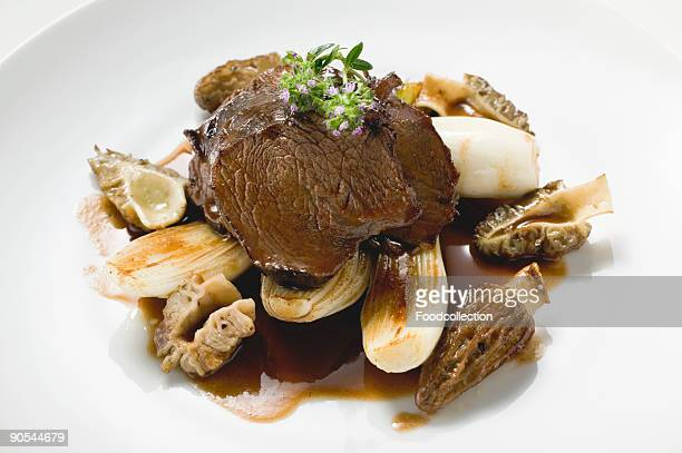 Roast beef with morels and garlic, close up