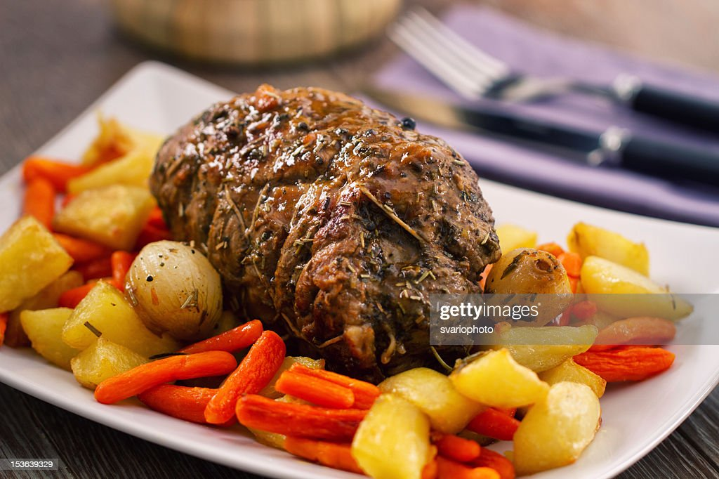 Roast Beef With Potatoes And Carrots Stock Photo | Getty Images