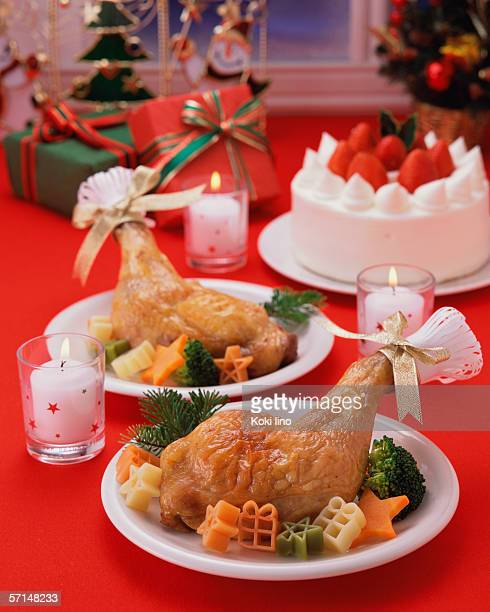 Roast chicken and strawberry cake served on table