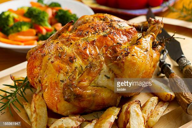 Roast chicken dinner, topped with thyme